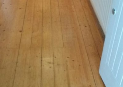 unstained wood floor